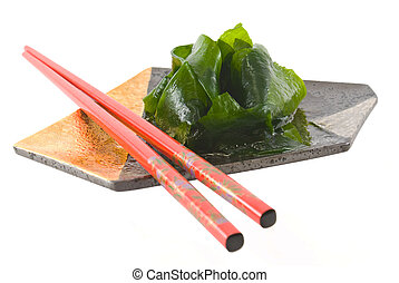 Asian vegetable dish with chopsticks