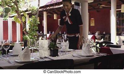 Asian waitress works in restaurant