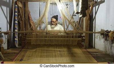 Asian weaver at work
