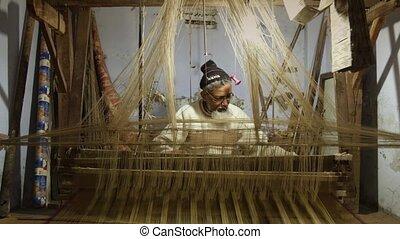 Asian weaver at work
