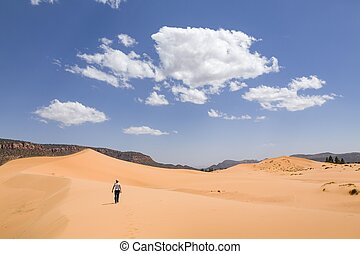 Asian woman alone in desert, Coral Pink Sand Dunes, Utah