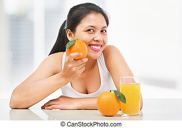 Asian woman and orange