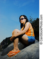 Asian Woman - Asian woman on rock by the beach