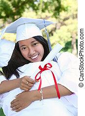 Asian Woman at Graduation - A pretty asian woman hugging a...