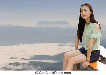 Asian woman at Sea Of Mist With Doi Luang Chiang Dao, View Form Doi Dam in Wianghaeng Chiangmai Thailand