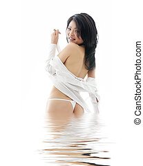 Asian Woman - Beautiful and sexy Asian woman wearing a white...