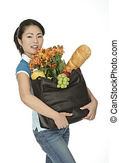 Asian Woman - Beautiful Asian woman carrying a bag of...