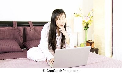 Asian woman buying online at home