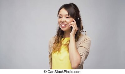 asian woman calling on smartphone - technology,...