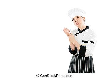 asian woman chef feel hand wrist pain injury