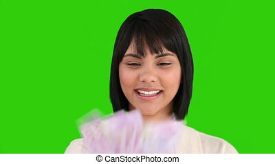 Asian woman counting her cash in front of the camera