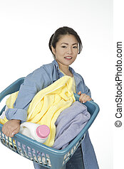 Asian Woman - Cute Asian woman holding a basket of laundry