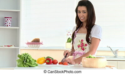 asian woman cutting vegetables - Bright asian woman cutting...