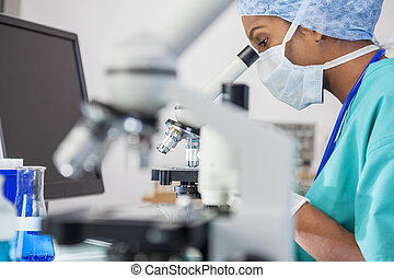 Asian Woman Doctor Scientist Using Microscope In Laboratory