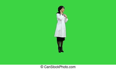 Asian woman doctor using smartphone on a Green Screen, Chroma Key
