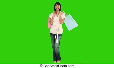 Asian woman doing shopping against a green screen