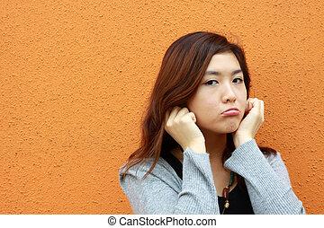 Asian woman doing something wrong