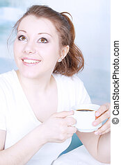 Asian woman drinking coffee