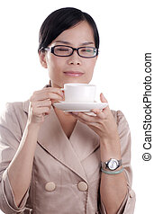 Asian Woman Drinking Coffee - Asian business woman about to...