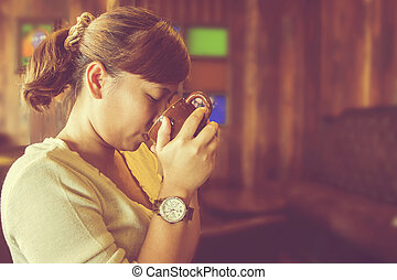 Asian woman drinking coffee. (Vintage process)