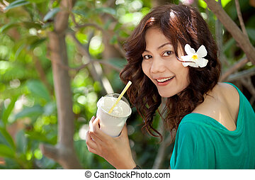asian woman drinking