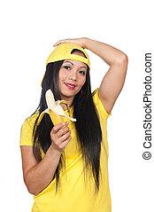 Asian woman eating a banana