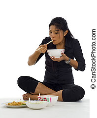asian woman eating with chop sticks