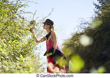 asian woman enjoying a walking in the nature