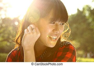 Asian woman enjoying the nature in sunlight