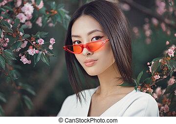 Asian woman fashion close-up portrait outdoors
