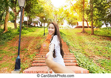 Asian woman follow me holding man hand happy smile leads...