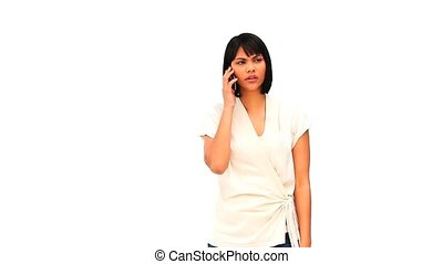 Asian woman getting nervous on the phone