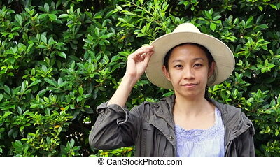 Asian woman green background