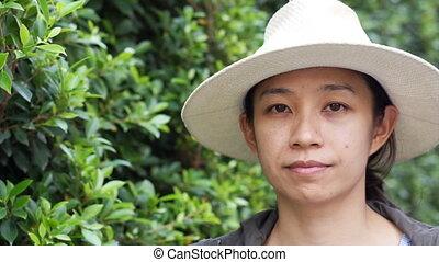 Asian woman green natural hat