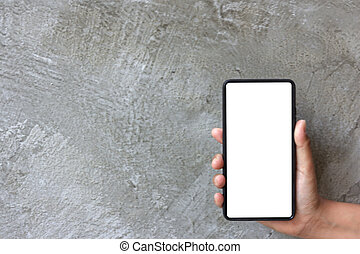 Asian woman hand hold mobile phone on grey cement background