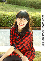 Asian woman happy in a park