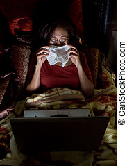 Asian woman having colds while working in the dark