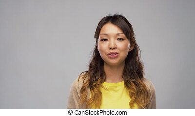 asian woman having video interview and talking - video...