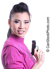 Asian woman holding a gun