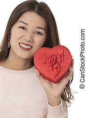 Asian woman holding a red heart isolated on white background