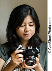 Woman holding an old film camera