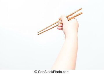 Asian woman holding brown chop stick, isolated