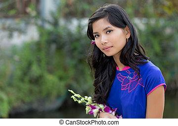 Asian woman holding fresh flowers