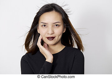 Asian Woman in black dress on white