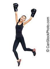 Asian woman in boxing gloves jumping in triumph of victory....