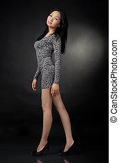 Asian woman in dress