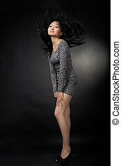 Asian woman in dress