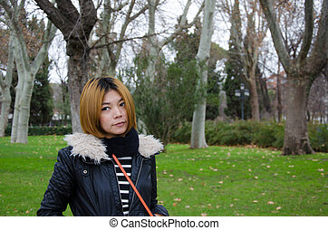 Asian woman in garden