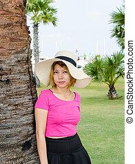 Asian woman in garden