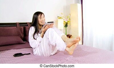Asian woman in love with technology